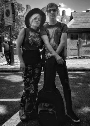 Katie and guitarist in Sing by Sobriety Films